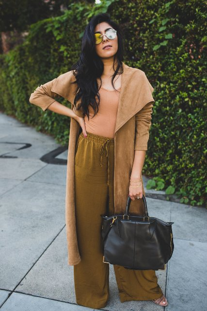 With beige top, brown suede cardigan, black leather tote bag and shoes
