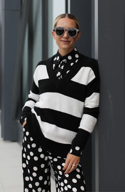 With black and white polka dot palazzo pants and blouse