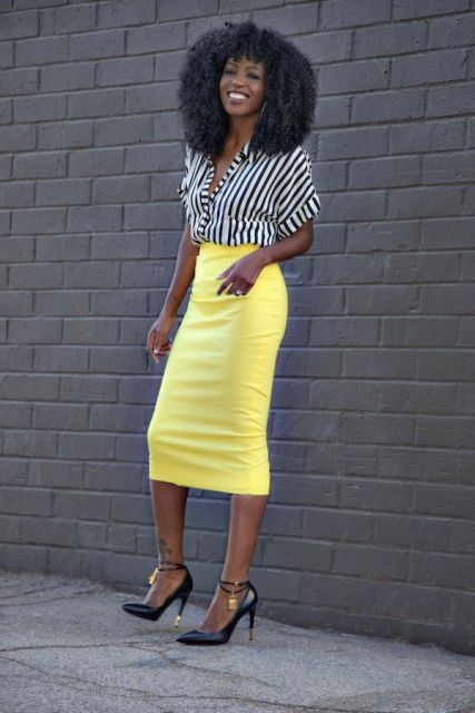 With black and white striped shirt and black ankle strap high heels
