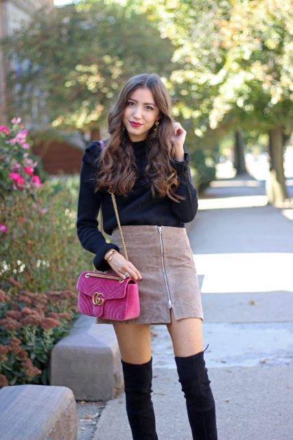 With black blouse, black suede over the knee boots and suede mini skirt