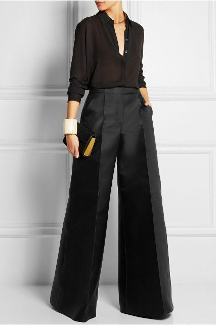With black button down blouse and black clutch