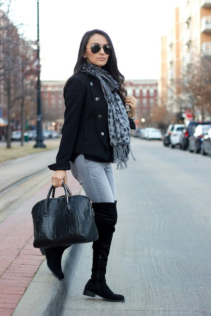 With black jacket, printed fringe scarf, gray jeans and tote bag