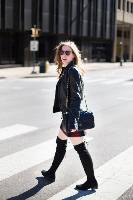 With black leather jacket, chain strap bag and printed skirt