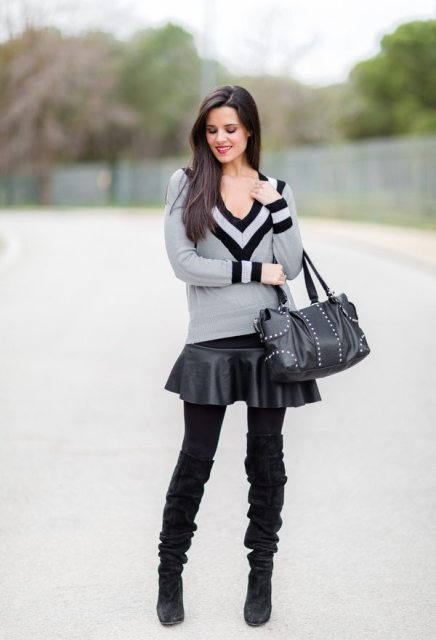 With black leather skirt, embellished bag and black suede high heeled boots