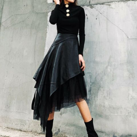 With black long sleeved shirt and mid calf boots