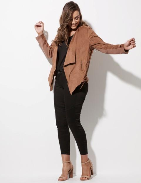 With black shirt, black crop pants and beige high heels