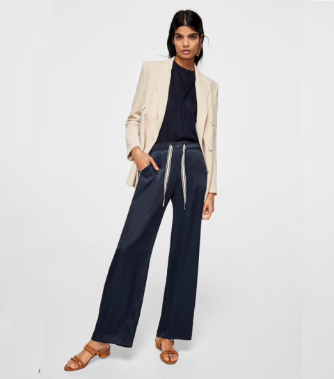 With black t-shirt, beige blazer and brown low heeled shoes