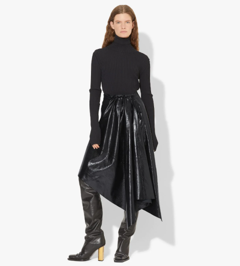 With black turtleneck and black high boots