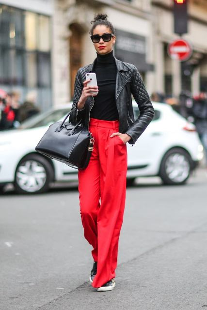 With black turtleneck, black leather jacket, black bag and sneakers