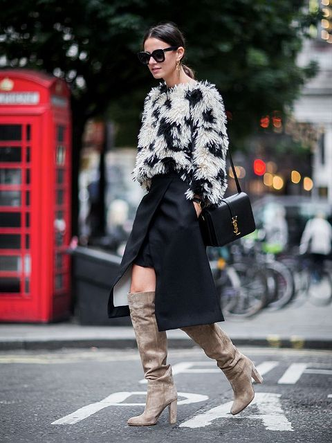 With black wrap skirt, black leather bag and gray over the knee boots