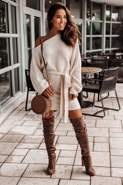 With brown suede over the knee boots and brown rounded bag