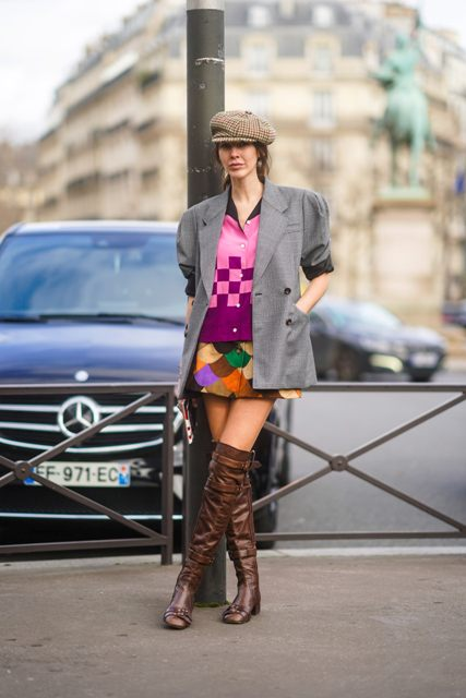 With checked cap, gray blazer, printed shirt and colorful mini skirt