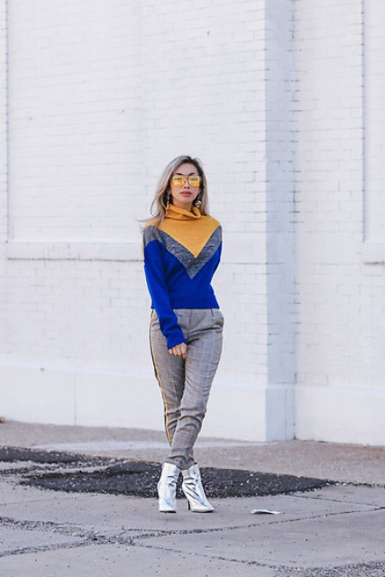 With color block turtleneck sweater and silver ankle boots