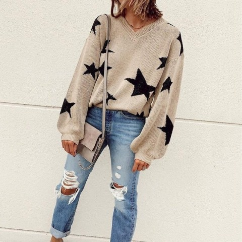 With distressed jeans and gray suede bag