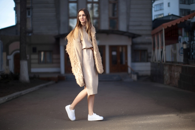 With faux fur coat, belt and white sneakers