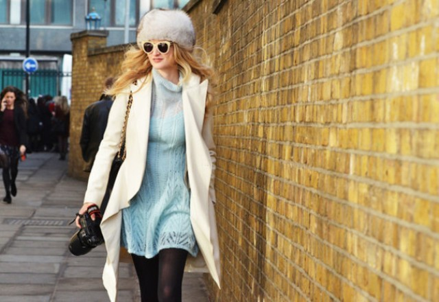 With faux fur hat, white coat and sunglasses