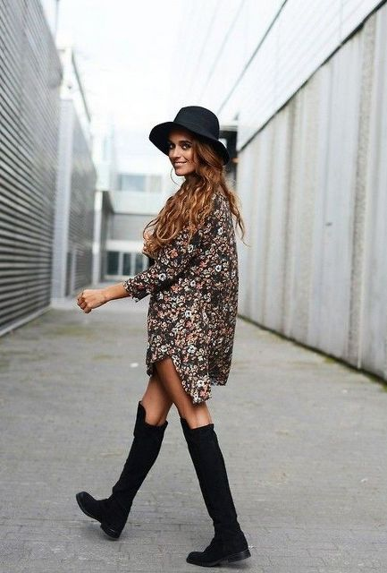 With floral mini dress and black hat