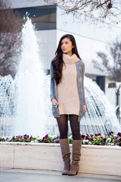 With gray cardigan and suede high boots