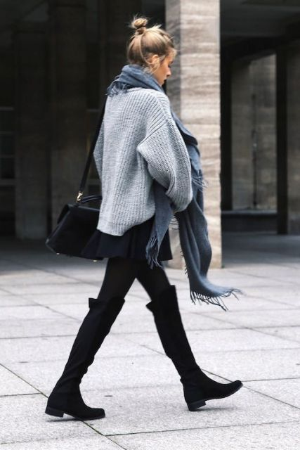 With gray loose sweater, gray scarf, black skirt and black bag