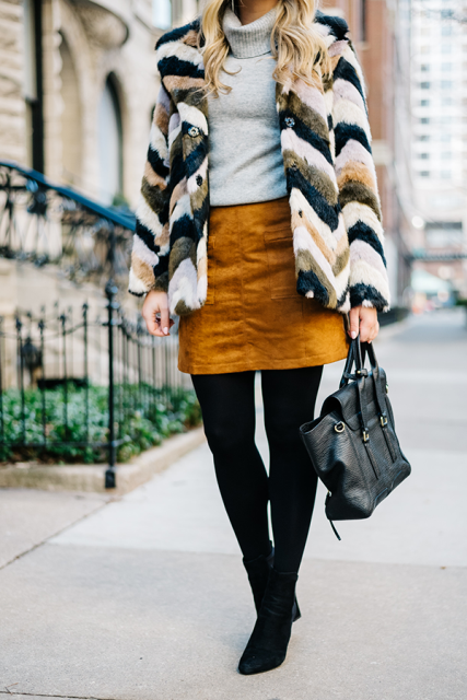 With gray sweater, brown suede skirt, boots and bag