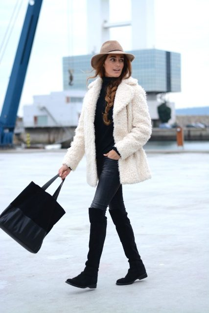 With jeans, black turtleneck, black tote bag, beige hat and white faux fur coat
