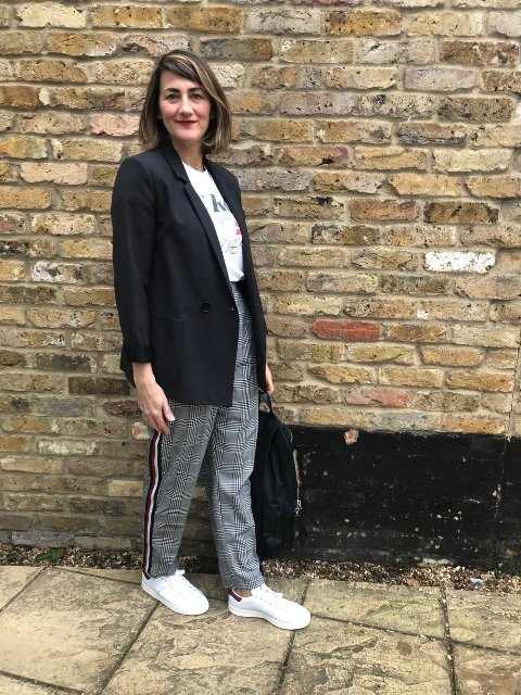With labeled t shirt, black long blazer and white sneakers