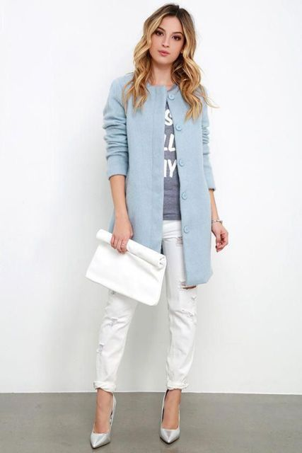 With labeled t-shirt, white cuffed pants, white clutch and silver pumps