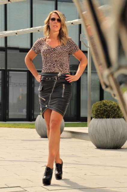 With leopard printed shirt and black lace up platform ankle boots