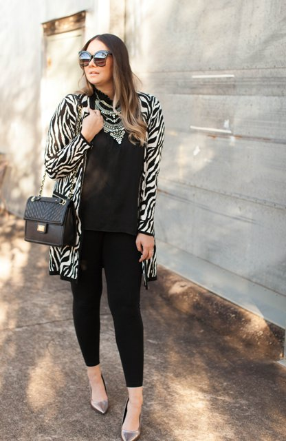 With loose shirt, leather bag, leggings and metallic shoes