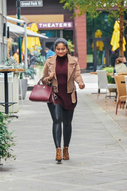 With marsala long sweater, black leather leggings, marsala bag and leopard printed ankle boots