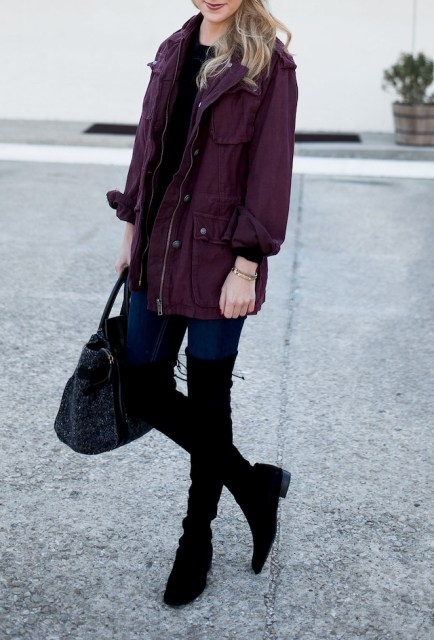 With navy blue jeans, black tote bag, black shirt and purple jacket