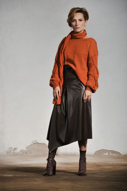 With orange sweater, scarf and high heeled shoes