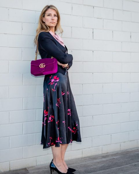 With pale pink blouse, cardigan, floral printed midi skirt and black shoes