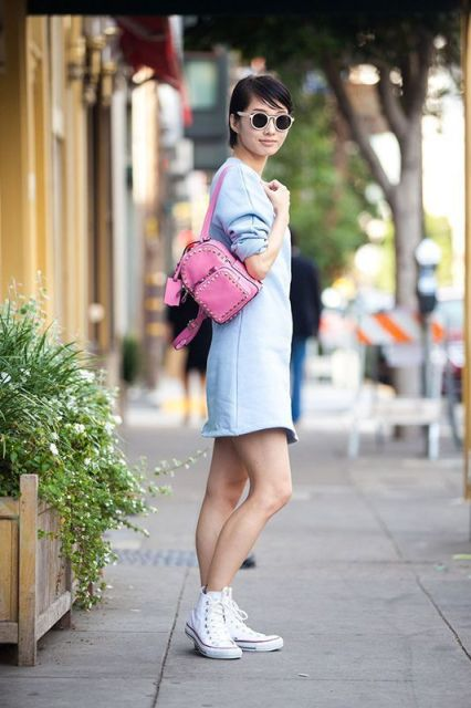 With pink embellished backpack and white sneakers