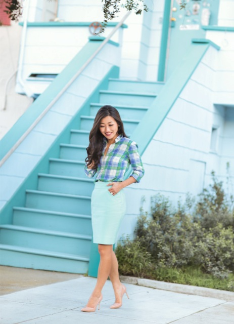 With plaid button down shirt and beige pumps