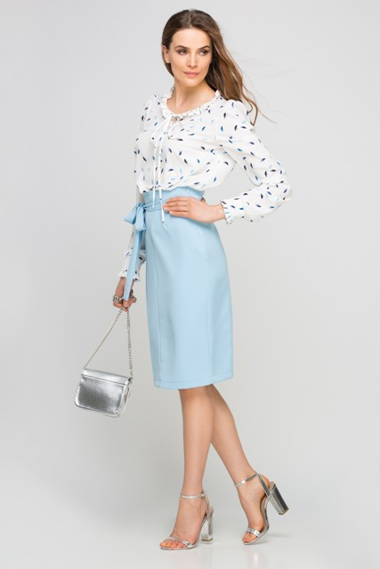 With printed blouse, silver mini bag and silver high heels
