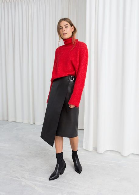With red loose sweater and black mid calf boots