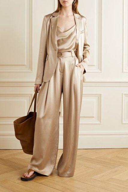With satin top, satin blazer, brown leather tote bag and brown shoes