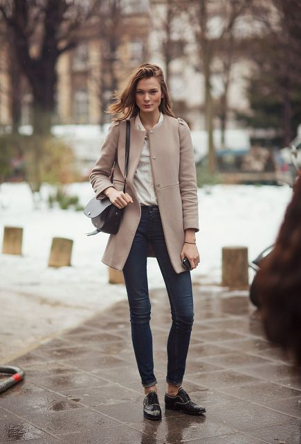 With skinny jeans, black flat shoes, black bag and white shirt
