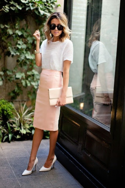With striped t-shirt, beige clutch and white shoes