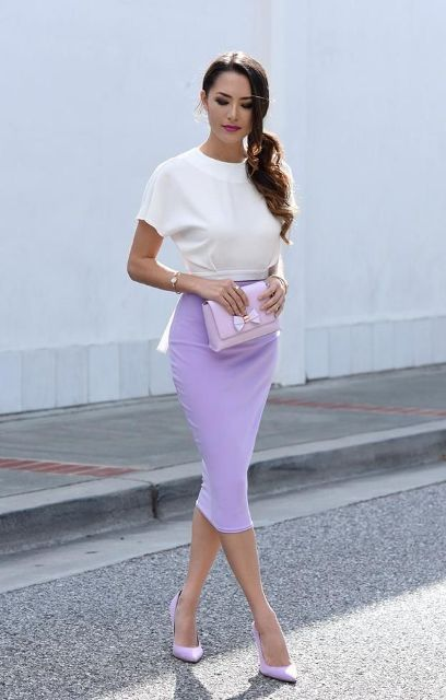 With white blouse, lilac clutch and lilac pumps