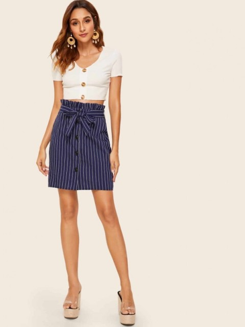 With white button down crop shirt and platform shoes