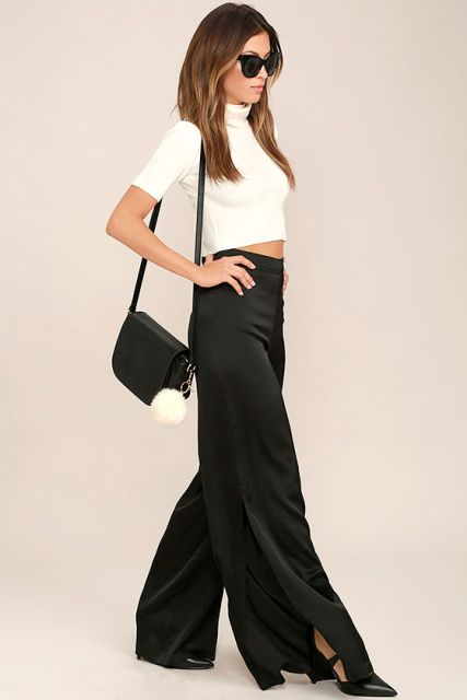 With white crop turtleneck, black leather bag and black shoes