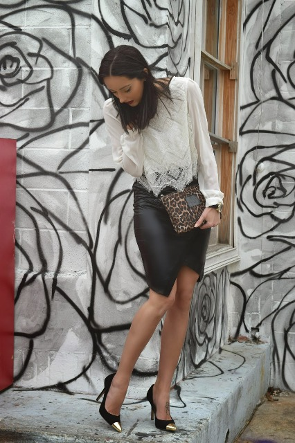 With white lace blouse, leopard printed clutch and black and golden pumps