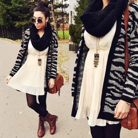 With white pleated dress, black scarf, brown bag and brown lace up boots