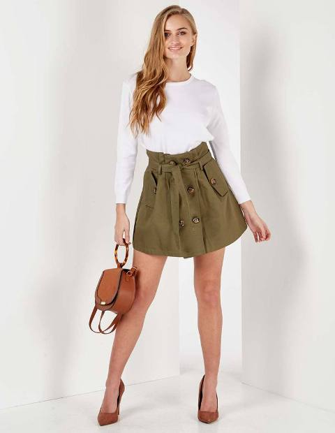 With white shirt, brown rounded bag and brown pumps