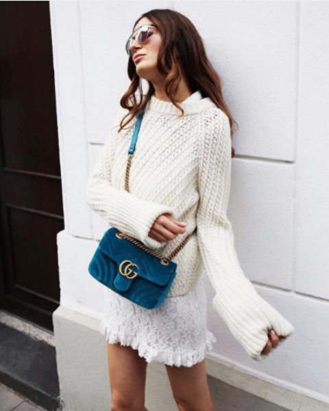 With white sweater and white lace mini skirt
