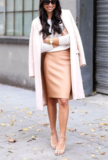 With white sweater, beige knee-length coat and high heels