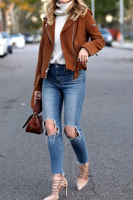 With white sweater, distressed jeans, brown bag and lace up high heels