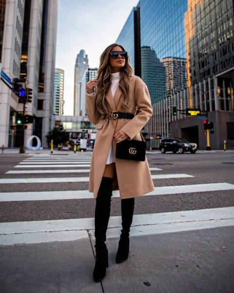 With white sweater dress, black over the knee boots and beige coat
